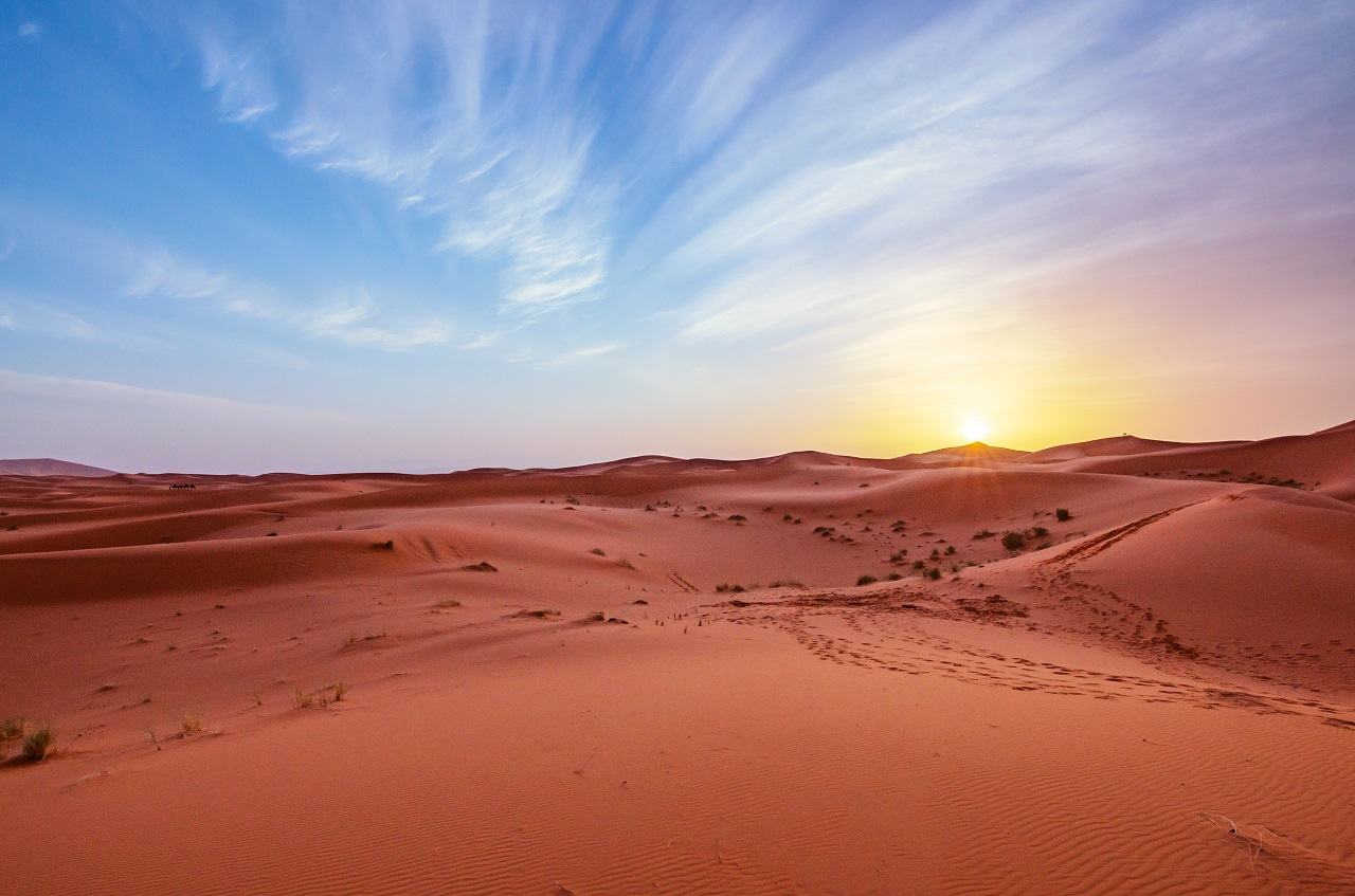 enjoying a scenic sunset view of the dunes